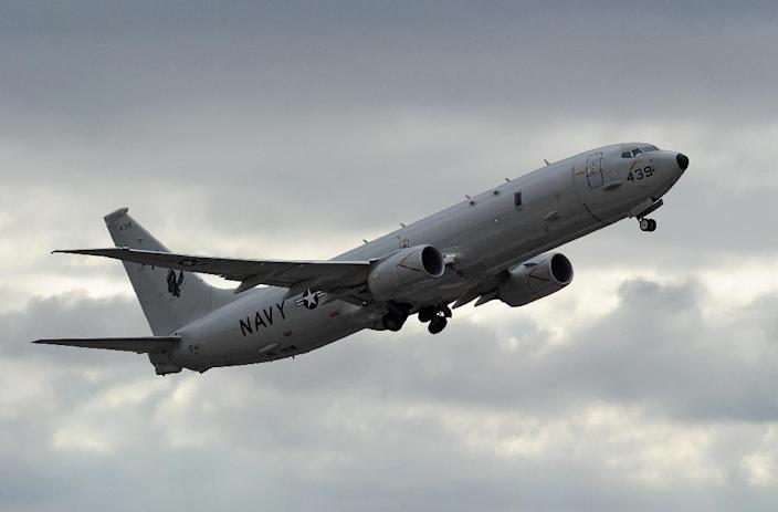 China on May 22, 2015, declared that its military 'drove away' a US surveillance aircraft, a P-8 Poseidon, flying near artificial islands in the South China Sea (AFP Photo/Greg Wood)
