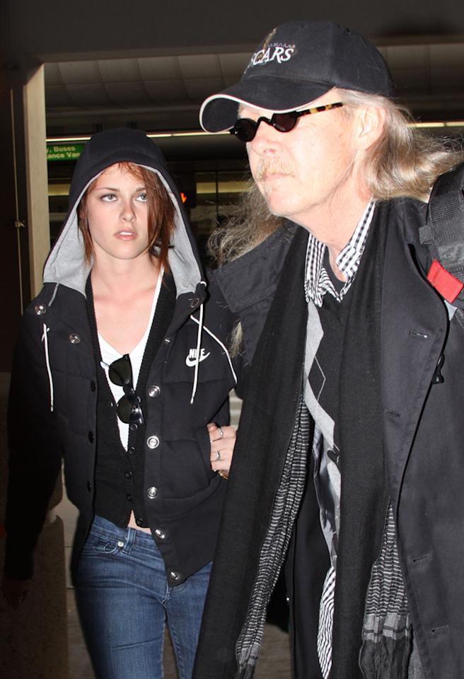 January 21, 2009: Kristen Stewart and father John Stewart spotted at LAX airport arriving after her trip to Washington D.C. for the 2009 Presidential Inauguration.