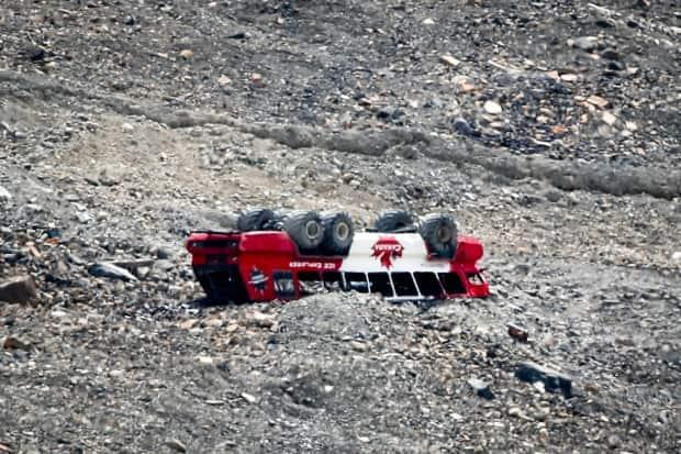 The all-terrain tour bus was carrying 27 people last summer when it rolled down an embankment, coming to rest on its roof.  (Jeff McIntosh/The Canadian Press - image credit)