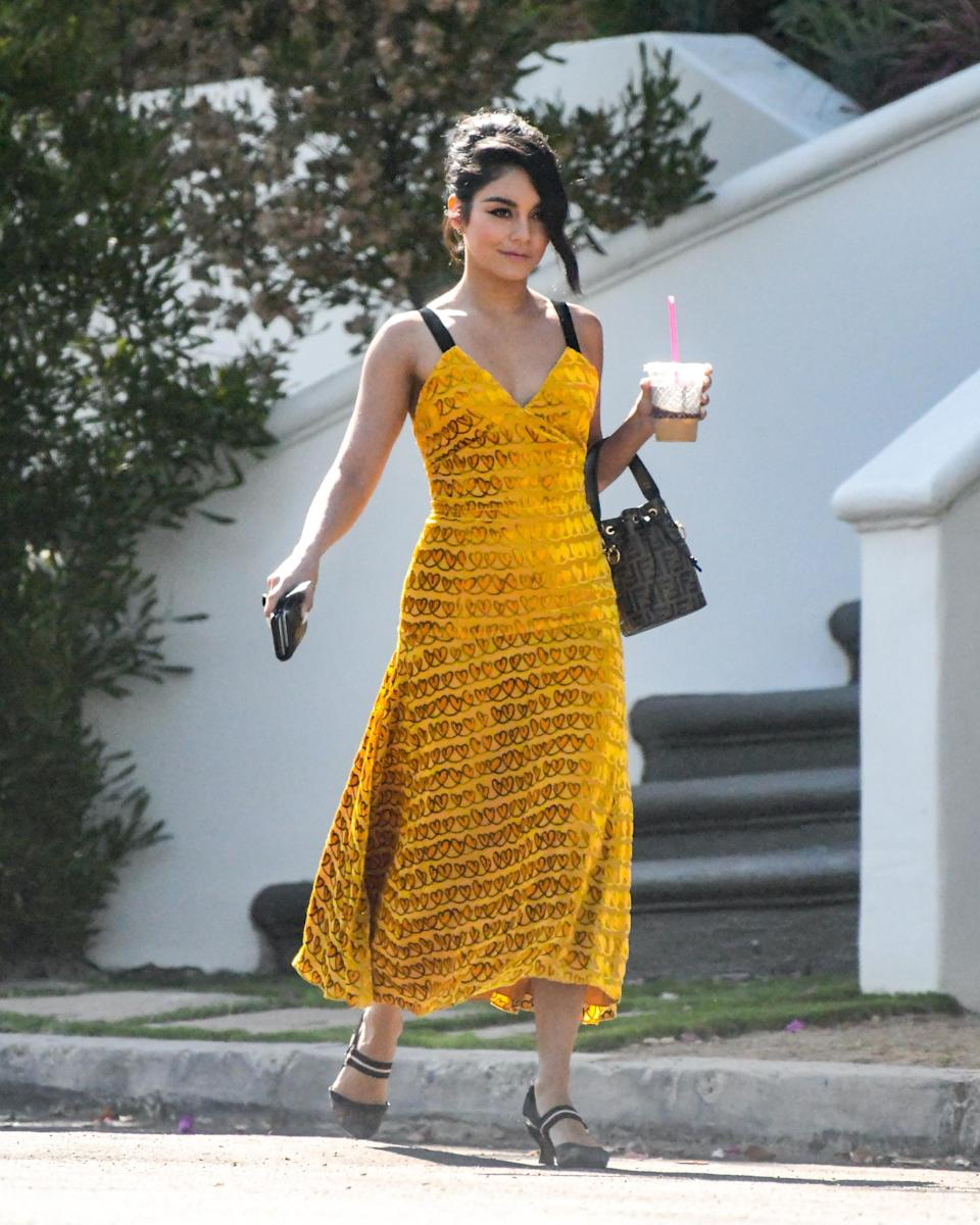<p>Vanessa Hudgens took a stroll in LA wearing a mustard yellow dress. P.S who said you couldn't velvet in summer? <em>[Photo: Getty]</em> </p>