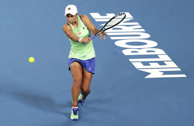 Australia's Ashleigh Barty makes a backhand return to Lesia Tsurenko of Ukraine during their first round singles match at the Australian Open tennis championship in Melbourne, Australia, Monday, Jan. 20, 2020. (AP Photo/Lee Jin-man)