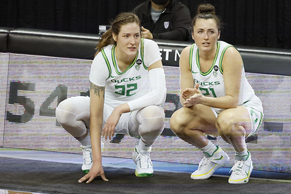 EUGENE, OREGON - FEBRUARY 28: Sedona Prince #32 and Erin Boley #21 of the Oregon Ducks wait to enter the game during the first half against the Oregon State Beavers at Matthew Knight Arena on February 28, 2021 in Eugene, Oregon. (Photo by Soobum Im/Getty Images)