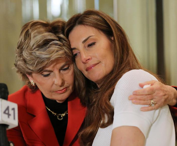 Karena Virginia is comforted by Gloria Alfred during a press conference where Karena Virginia identified herself as victim of sexual misconduct by Republican Presidential Candidate Donald Trump at a press conference at The London Hotel on October 20, 2016 in New York City. (Photo: Jemal Countess/Getty Images)