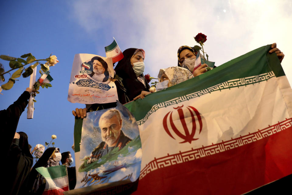 Supporters of Iranian president-elect Ebrahim Raisi celebrate after he won the presidential election in Tehran, Iran, Saturday, June 19, 2021. Initial results released Saturday propelled Raisi, a protege of the country's supreme leader, into Tehran's highest civilian position. The vote appeared to see the lowest turnout in the Islamic Republic's history. (AP Photo/Ebrahim Noroozi)