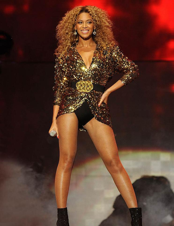 """The one-and-only Beyonce didn't disappoint as the headliner of this year's star-studded Glastonbury Music Festival. The diva extraordinaire showed off her signature stems in a belted, gold sequined Alexandre Vauthier mini dress, black hot pants, and bedazzled booties while treating the 50,000 screaming fans to a scorching 90-minute set. Optic Photos/<a href=""""http://www.pacificcoastnews.com/"""" target=""""new"""">PacificCoastNews.com</a> - June 26, 2011"""
