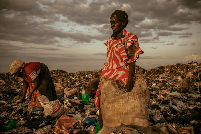 """<b>First Place for People: Amongst the Scavengers</b> <br> At the end of the day women are allowed to pick through the dumpsite. <a href=""""http://ngm.nationalgeographic.com/ngm/photo-contest/"""" rel=""""nofollow noopener"""" target=""""_blank"""" data-ylk=""""slk:(Photo and caption by Micah Albert/National Geographic Photo Contest)"""" class=""""link rapid-noclick-resp"""">(Photo and caption by Micah Albert/National Geographic Photo Contest)</a>"""