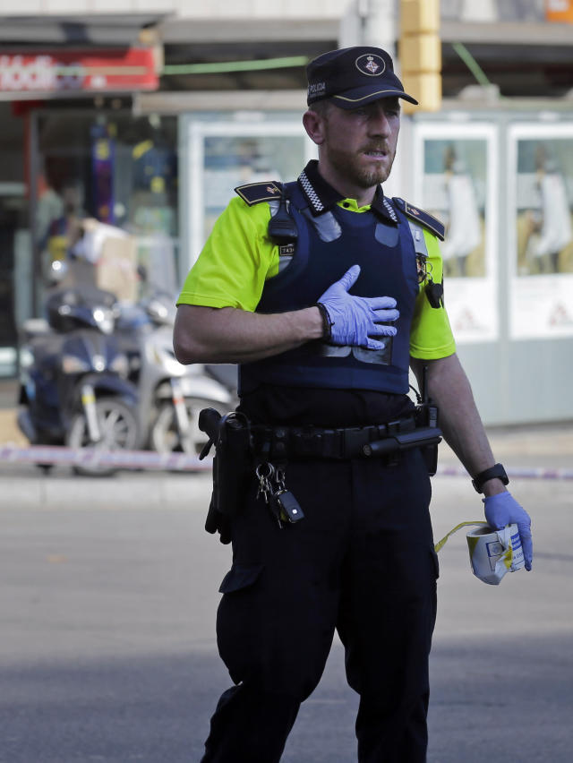 <p>A police officer cordons off a street in Barcelona, Spain, Thursday, Aug. 17, 2017. Police in the northern Spanish city of Barcelona say a white van has jumped the sidewalk in the city's historic Las Ramblas district, injuring several people. (AP Photo/Manu Fernandez) </p>