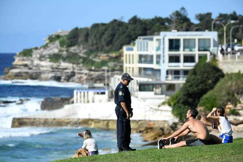 NSW Police ask people to move on while patrolling during the Easter long weekend at Bondi Beach in Sydney.