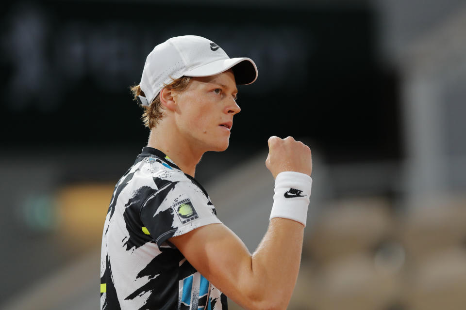 Italy's Jannik Sinner clenches his fist after scoring a point against Belgium's David Goffin in the first round match of the French Open tennis tournament at the Roland Garros stadium in Paris, France, Sunday, Sept. 27, 2020. (AP Photo/Christophe Ena)