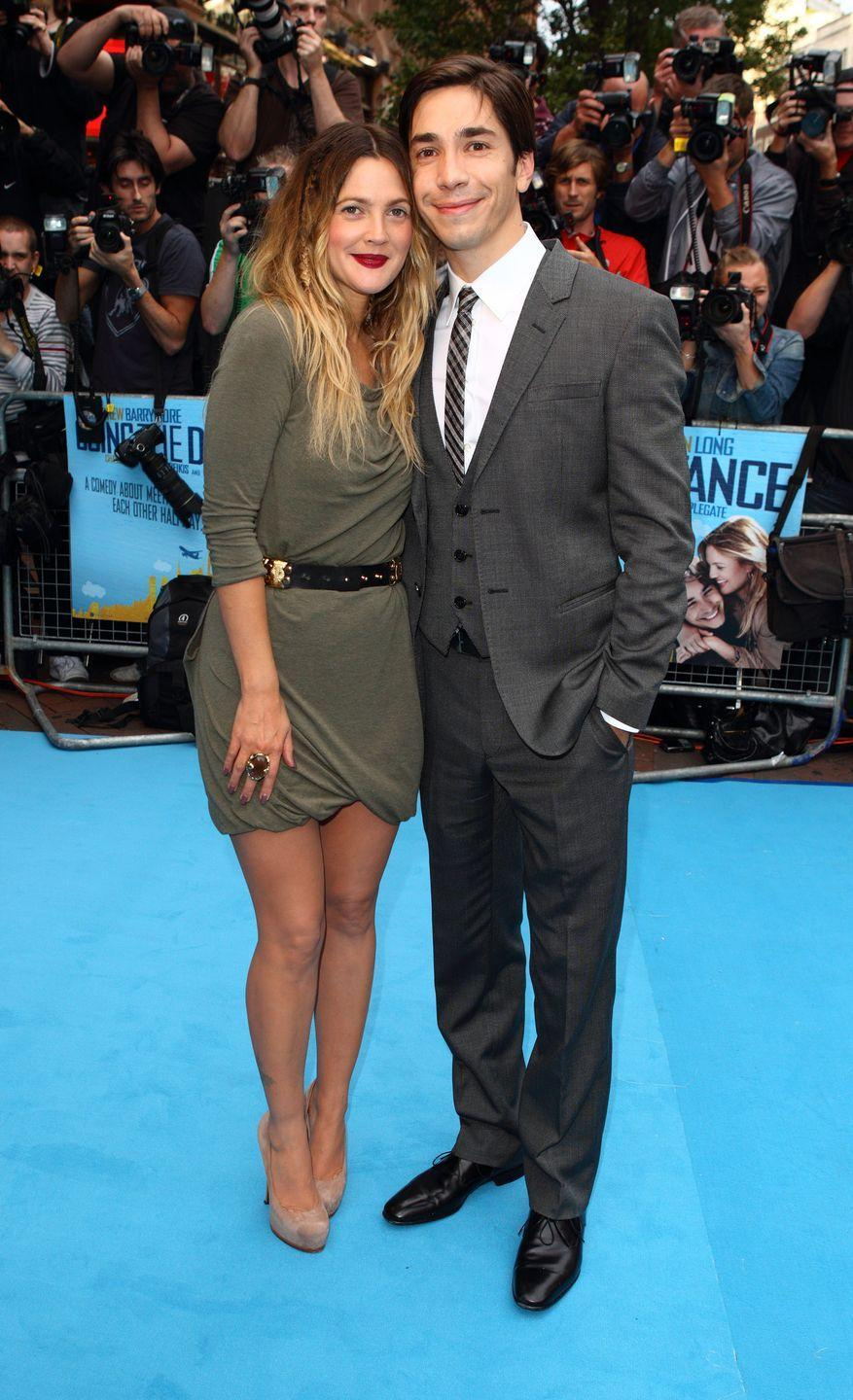 <p>Drew Barrymore and Justin Long started dating in 2007, after meeting on set for <em>He's Just Not That Into You.</em> The relationship lasted just a year and they broke up in 2008. Despite splitting up, the pair had rekindled their romance on-screen for the 2010 film <em>Going the Distance. </em></p>