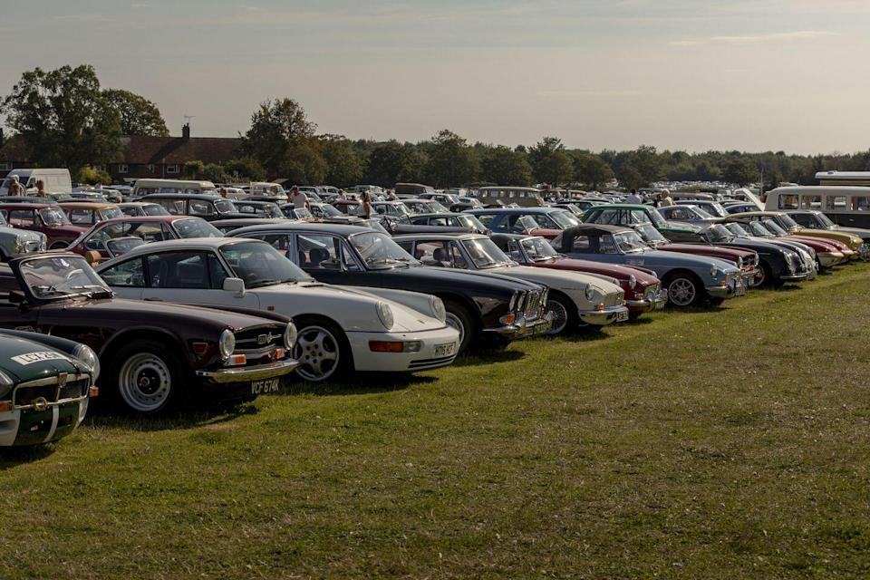 """<p>Ditting's DB4GT, shared with pro driver and classic car expert Sam Hancock, was one of several in the paddock. But here's more magic of the Revival: when I told another colleague about it, he asked me, """"Have you been to the parking lot? There's probably another six DB4GTs out there."""" The Revival is the only car event I've ever been to where I was asked repeatedly, """"Have you been to the parking lot?"""" A car show in itself, where space constraints enforce the democracy of a gaggle of MGs and Triumphs parked with vintage and modern Porsches, Jaguars, BMWs, at least one Ferrari Dino, and a three-wheeled Reliant Bond Bug. On Friday and Saturday, these treasures sat on the dirt. On Sunday, when it rained, they sat in the mud.</p>"""