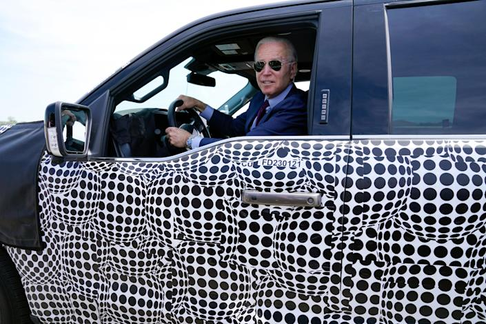 Joe Biden stops to talk to the media as he drives a Ford F-150 Lightning  (AP)