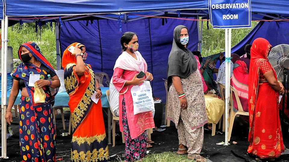 People waiting to get vaccinated against Covid-19 at a camp in Rajghat, on 15 September 2021 in New Delhi, India