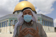 A Palestinian man prays at the Dome of the Rock Mosque in the Al Aqsa Mosque during Friday prayers before a protest celebrating the six Palestinian prisoners who recently tunneled out of the Gilboa Prison, in the Old City of Jerusalem, Friday, Sept. 10, 2021. (AP Photo/Mahmoud Illean)