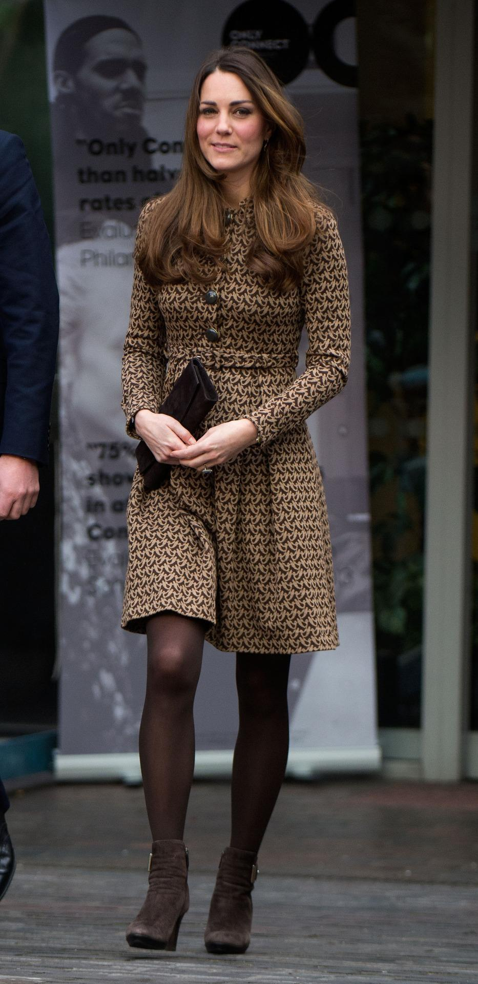 <p>For a charity visit, Kate wore a printed Orla Kiely dress with brown Aquatalia heeled boots and a matching clutch. </p><p><i>[Photo: PA]</i></p>