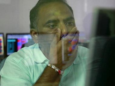 Sensex, Nifty slip into red after touching record levels in opening trade; Reliance Industries, TCS, HDFC among major losers