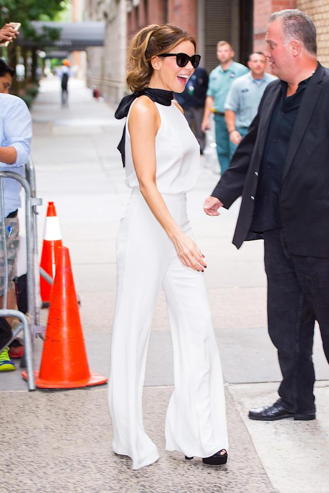 Beckinsale started her Tuesday morning with a white jumpsuit. (Photo: Getty Images)