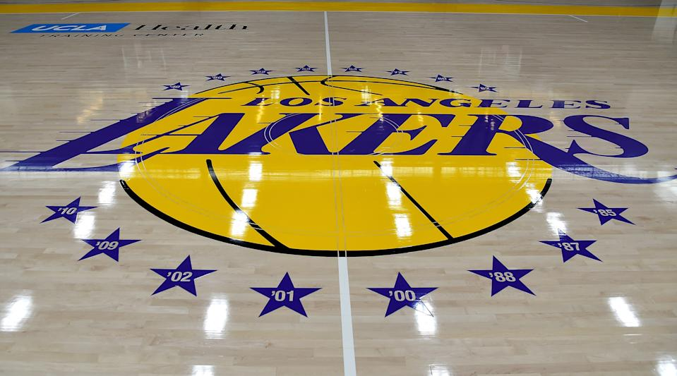 The Lakers joined a growing list of NBA teams either confirming or reported to have positive COVID-19 cases. (Jayne Kamin-Oncea/Getty Images)