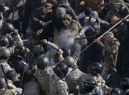 Radical protesters clash with law enforcement members on the Day of Ukrainian Cossacks during a rally near the parliament building in Kiev