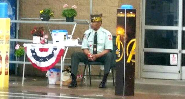 Manuel Griffin was kept from sitting under an awning during his rainy-day fundraising efforts in front of a Walmart recently. (Photo: Maryann Griffin via Facebook)