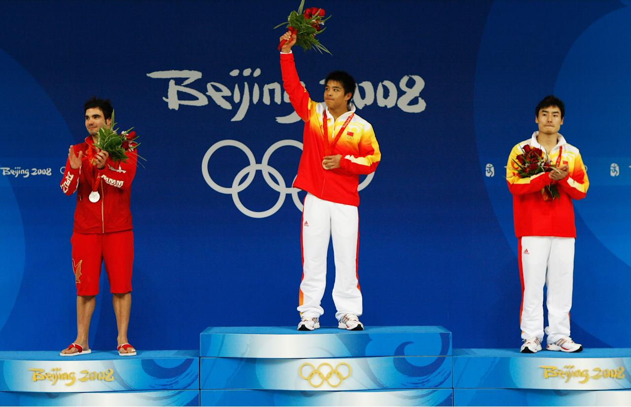 BEIJING - AUGUST 19: (L-R) Silver medalist Alexandre Despatie of Canada, gold medalist He Chong of China and bronze medalist Qin Kai of China pose with their medals after winning the Men's 3m Springboard Fiinal at the National Aquatics Center on Day 11 of the Beijing 2008 Olympic Games on August 19, 2008 in Beijing, China. (Photo by Streeter Lecka/Getty Images)