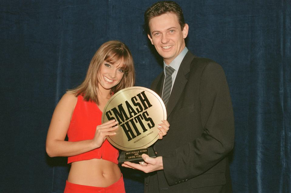 The Smash Hits Poll Winners Party, 1996 hosted by Ant and Dec, and Lily Savage. Picture taken 1st December 1996 Picture shows singer Louise Nurding with her Best Female Singer Award, and then Daily Mirror show business columnist Matthew Wright. (Photo by Ian Vogler, Chris Grieve and Tim An/Mirrorpix/Getty Images)