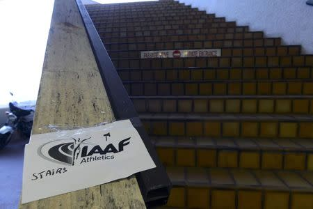 A photocopy indicating the venue access for the media is fixed by the stairs that access the Fairmont Hotel where the IAAF Council hosts a news conference after a meeting to discuss the latest developments in the doping and corruption crisis that has gripped the sport over recent months, in Monaco, November 26, 2015. REUTERS/Jean-Pierre Amet