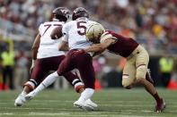 Virginia Tech quarterback Ryan Willis (5) fumbles the ball as he is sacked by Boston College defensive back Tate Haynes, right, during the first half of an NCAA college football game in Boston, Saturday, Aug. 31, 2019. (AP Photo/Michael Dwyer)