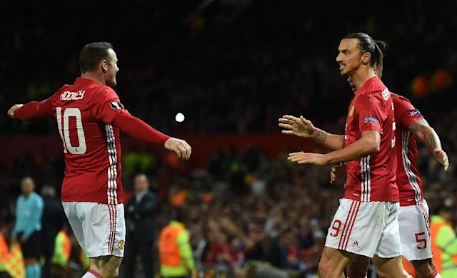 Manchester United's striker Zlatan Ibrahimovic (R) celebrates scoring his team's first goal with Manchester United's striker Wayne Rooney (L) during the UEFA Europa League group A football match between Manchester United and Zorya Luhansk (AFP Photo/Paul Ellis)