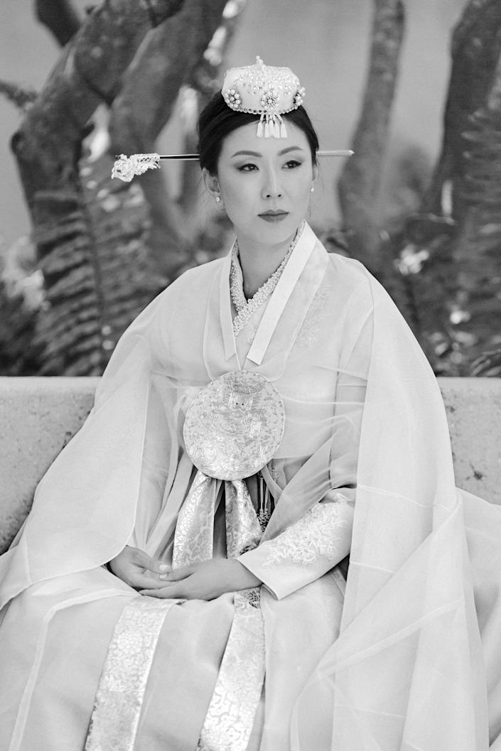 It was so important to me that I incorporated a <em>hanbok</em> as one of my dresses during my wedding weekend. This <em>hanbok</em> was six layers but surprisingly very light and cool. The hairpin is called a <em>binyeo</em>. It is believed to capture the wearer's spirit.