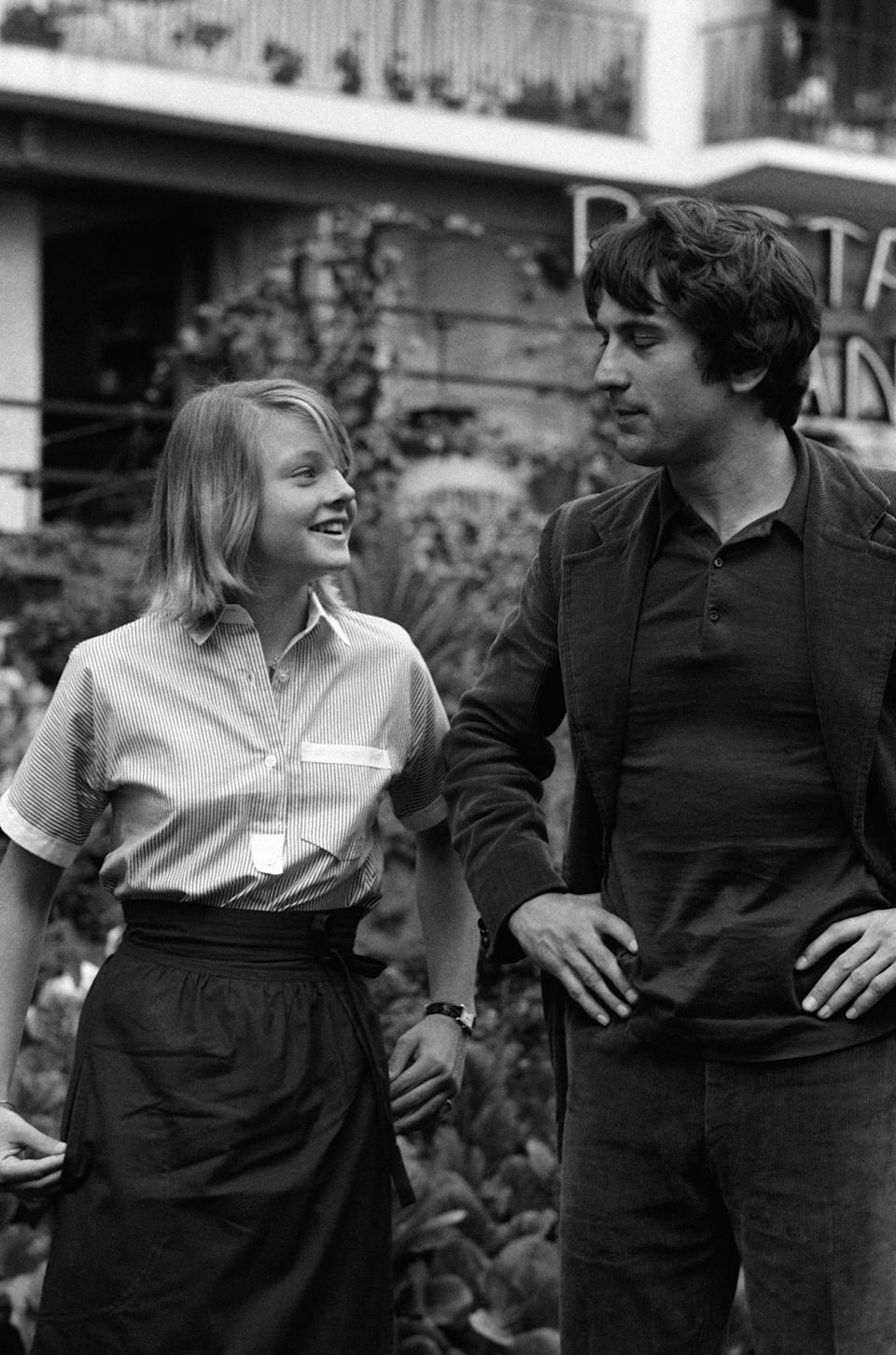 CANNES, FRANCE - MAY: Jodie Foster and Robert De Niro, actors of movie Taxi Driver directed by Martin Scorsese at Cannes Film Festival in May 1976 in Cannes, France. (Photo by Pool GINFRAY/SIMON/Gamma-Rapho via Getty Images)