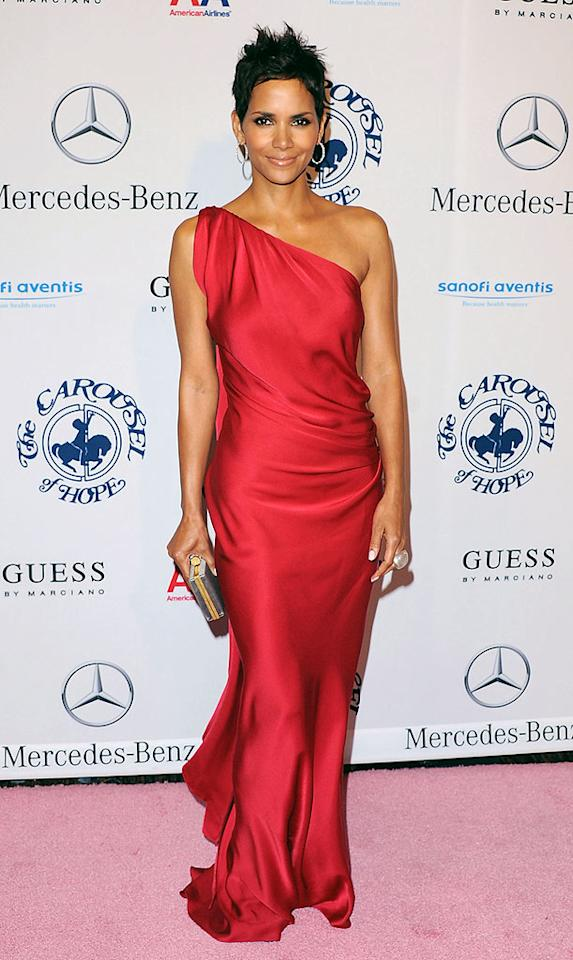 """Looking flawless as usual, Halle Berry blew away the competition at the Carousel of Hope Ball in Beverly Hills Sunday when she donned a stunning red YSL Pre-Fall 2010 gown. The star accessorized with a YSL box clutch and her handsome new beau Olivier Martinez (unfortunately not pictured). Jon Kopaloff/<a href=""""http://www.filmmagic.com/"""" target=""""new"""">FilmMagic.com</a> - October 23, 2010"""