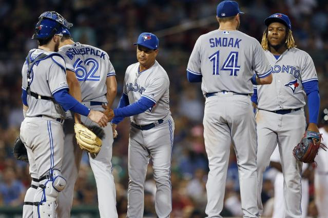 Toronto Blue Jays manager Charlie Montoyo, center, removes Jacob Waguespack (62) during the fifth inning of the team's baseball game against the Boston Red Sox in Boston, Tuesday, July 16, 2019. (AP Photo/Michael Dwyer)