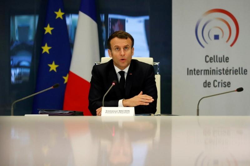 FILE PHOTO: French President Emmanuel Macron attends a meeting at the emergency crisis center of the Interior Ministry in Paris