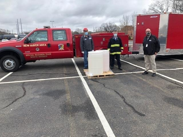 Allnex Site Manager Frank DiCristina (far right) pictured with allnex Fire Department Chief Fritz Hughes (left) and Wallingford Fire Department's Lt. Mike Krupinski (center).