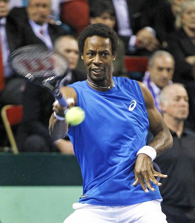 France's Gael Monfils returns the ball to German player Peter Gojowczyk, during their single match in the quarterfinals of the Davis Cup in Nancy, eastern France, Sunday April 6, 2014.(AP Photo/Remy de la Mauviniere)