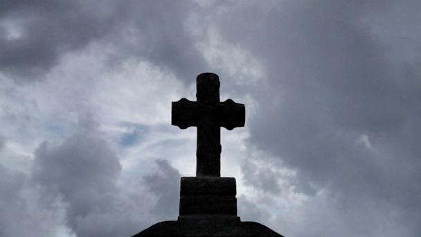PHOTO: A cross sits atop an elevated headstone at Gates of Prayer cemetery in Louisiana on Aug. 28, 2020. Saturday marks the 15th anniversary of Hurricane Katrina in New Orleans. (Shannon Stapleton/Reuters)