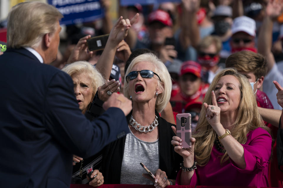 Supporters of President Donald Trump cheer as he walks off stage after speaking at a campaign rally at Pitt-Greenville Airport, Thursday, Oct. 15, 2020, in Greenville, N.C. (AP Photo/Evan Vucci)