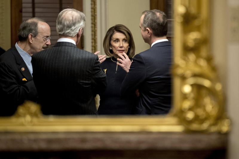 House Speaker Nancy Pelosi of Calif., center, speaks with House Intelligence Committee Chairman Adam Schiff, D-Calif., right, House Foreign Affairs Committee Chairman Eliot Engel, D-N.Y., left, and House Ways and Means Committee Chairman Richard Neal, D-Mass., second from left, in a private room just off the House floor after the House votes to impeach President Donald Trump, Wednesday, Dec. 18, 2019, on Capitol Hill in Washington. (AP Photo/Andrew Harnik)