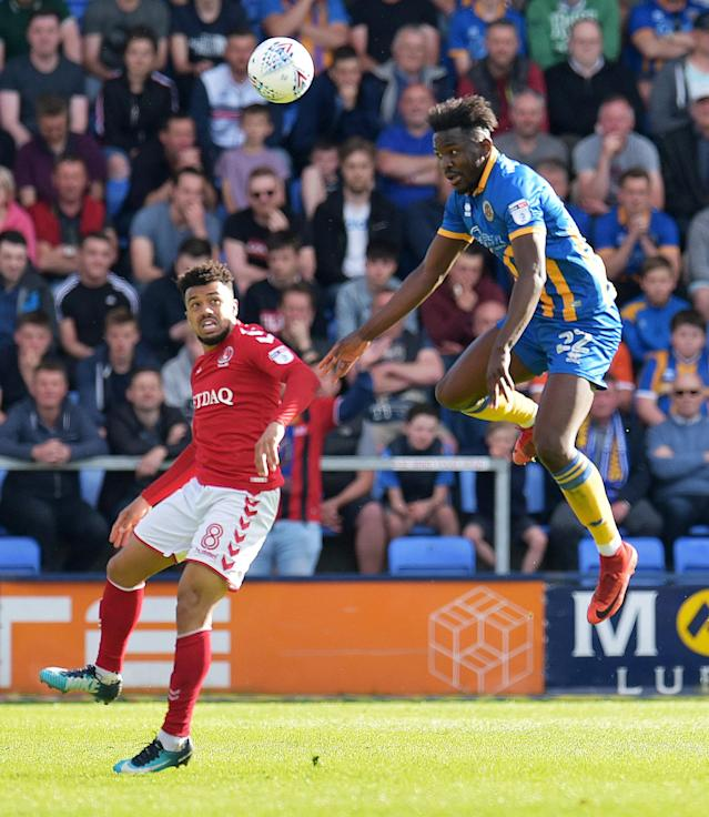 "Soccer Football - League One Play Off Semi Final Second Leg - Shrewsbury Town vs Charlton Athletic - Montgomery Waters Meadow, Shrewsbury, Britain - May 13, 2018 Shrewsbury Town's Toto Nsiala in action with Charlton Athletic's Nicky Ajose Action Images/Paul Burrows EDITORIAL USE ONLY. No use with unauthorized audio, video, data, fixture lists, club/league logos or ""live"" services. Online in-match use limited to 75 images, no video emulation. No use in betting, games or single club/league/player publications. Please contact your account representative for further details."