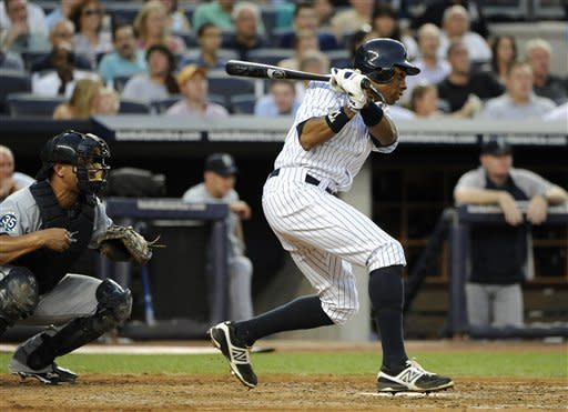 New York Yankees' Curtis Granderson follows through on a two-run single off of Seattle Mariners starting pitcher Kevin Millwood in the third inning of a baseball game Friday, Aug. 3, 2012, at Yankee Stadium in New York. (AP Photo/Kathy Kmonicek)
