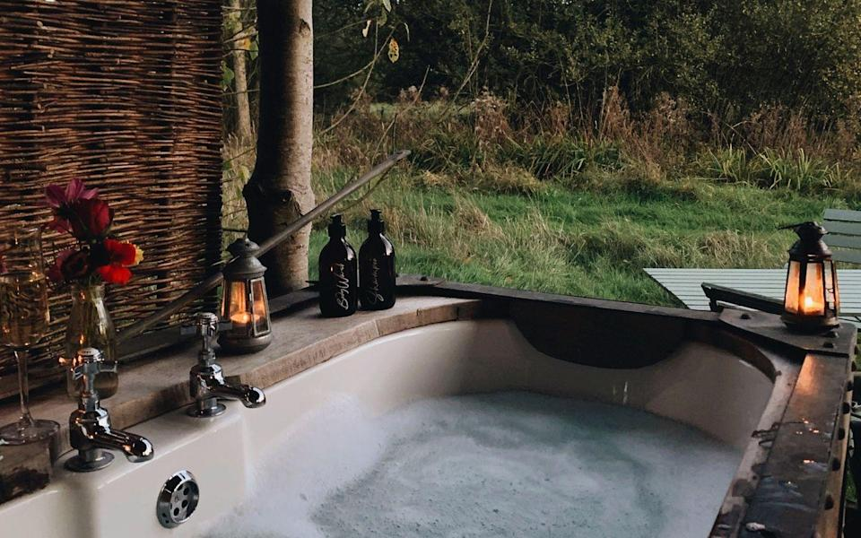 """<p>There's nothing quite like sipping on a glass of prosecco while lying in an outdoor bath in the countryside. And that's exactly what we'll be doing with our S.O. this summer at Albion Nights. </p><p>A quaint eco-cabin in six acres of wildflower meadows, this property is self-catered and just 15 minutes away from the city of Norwich, with hiking and wild swimming on offer nearby. Better yet, the hosts have just introduced wellness treatments such as massages, reiki and reflexology.</p><p>With comfort at the heart of everything here, the open plan living space is rustic but warm and comes with a hob and fridge to store bubby and ingredients for romanctic home-cooked meals. Our favourite bit (other than the tub, of course) is the all-wooden interiors in the bedroom. </p><p><a class=""""link rapid-noclick-resp"""" href=""""https://thewanderlist.uk/properties/albion-nights/"""" rel=""""nofollow noopener"""" target=""""_blank"""" data-ylk=""""slk:BOOK HERE"""">BOOK HERE</a></p>"""