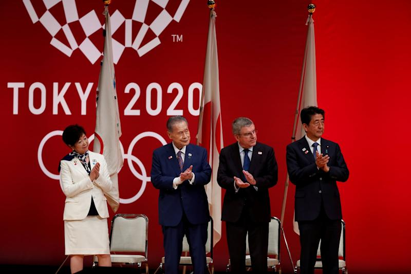 File photo: Tokyo 2020 chief Yoshiro Mori (second from left) and Japan's PM Shinzo Abe (right) attend a 'One Year to Go' ceremony in July 2019: REUTERS
