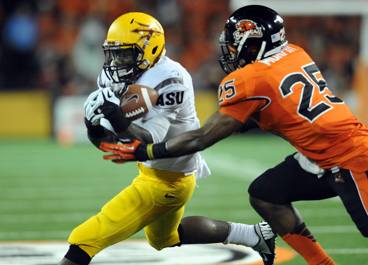 CORVALLIS, OR - NOVEMBER 03: Running back Marion Grice #1 of the Arizona State Sun Devils bobbles the ball as he makes a catch with safety Ryan Murphy #25 of the Oregon State Beavers defending in the second quarter of the game on November 3, 2012 at Reser Stadium in Corvallis, Oregon. (Photo by Steve Dykes/Getty Images)
