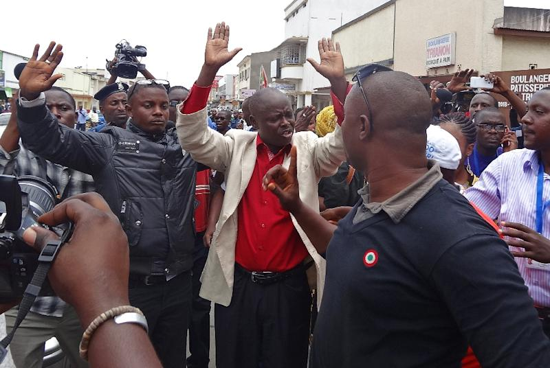 Protestors gesture during a gathering of opposition activists concerned at incumbent President's expected bid for a third term in June elections in Bujumbura on April 17, 2015
