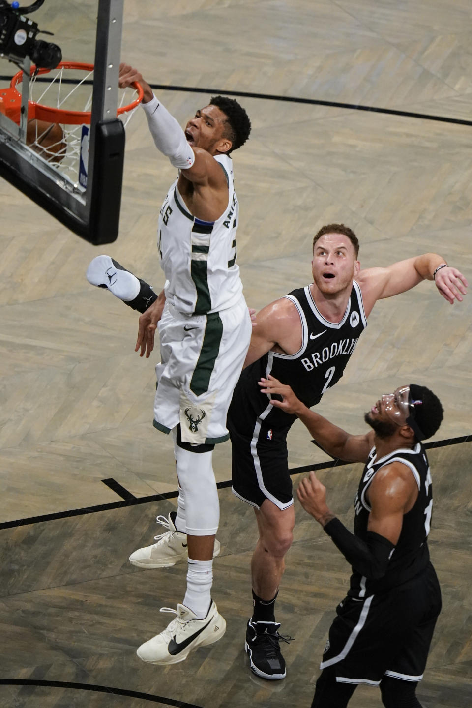 Milwaukee Bucks' Giannis Antetokounmpo, left, dunks in front of Brooklyn Nets' Blake Griffin (2) and Bruce Brown during the second half of Game 7 of a second-round NBA basketball playoff series Saturday, June 19, 2021, in New York. (AP Photo/Frank Franklin II)