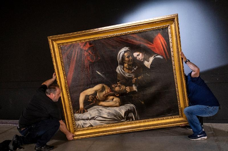 The painting depicts a grisly biblical scene of the beautiful Jewish widow Judith beheading a sleeping Assyrian general (AFP Photo/ERIC CABANIS)