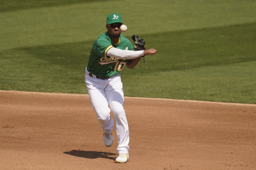 Oakland Athletics shortstop Marcus Semien throws out Chicago White Sox's Luis Robert at first base during the fourth inning of Game 2 of an American League wild-card baseball series Wednesday, Sept. 30, 2020, in Oakland, Calif. (AP Photo/Eric Risberg)