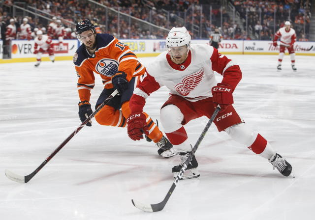 Detroit Red Wings' Nick Jensen (3) is chased by Edmonton Oilers' Alex Petrovic (15) during first period NHL action in Edmonton on Tuesday, Jan. 22, 2019. (Jason Franson/The Canadian Press via AP)