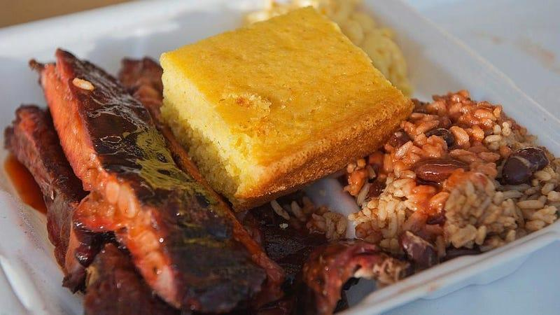 Barbecue spare ribs, red beans and rice, macaroni and cheese and cornbread in foam container